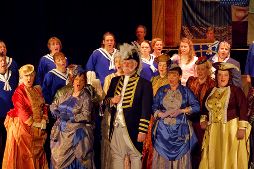 Ciur Joseph Porter KCB surrounded by the crew and his sisters, cousins and aunts abord the HMS Pinafore